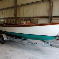 Harrison Boatworks was charged with the task of putting this  boat together and making it run with an electric motor powered by four 8D batteries and a mechanical steering system that is very interesting. This boat was built by Tom Hesselink in Marshallberg, N.C.