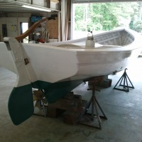 Harrison Boatworks has repainted the bottom, the hull and the washboards and fabricated a few new parts for the rudder. Bayliss Boatworks did the restoration on this boat a few years ago.